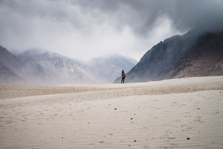 Woman Standing Against Mountain At Nubra Valley