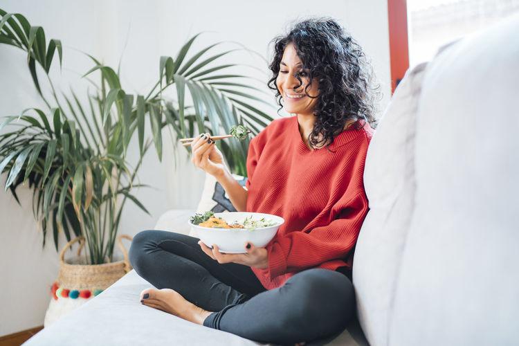 Woman eating food on table