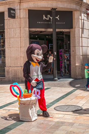 Malaga, Spain - May 26, 2018. Disney Mickey Mouse costumed character selling balloons to children at Constitution square, Malaga city, Costa del Sol, Malaga Province, Andalucia, Spain, Western Europe Disney Disney World Malaga SPAIN Architecture Building Exterior Built Structure City Clothing Constitution Costumed Day Disney Cartoon Footpath Front View Full Length Holding Leisure Activity Lifestyles Mickey Mouse Mickey Mouse Costumed One Person Outdoors Real People Standing Street Women Young Adult The Street Photographer - 2018 EyeEm Awards The Great Outdoors - 2018 EyeEm Awards The Photojournalist - 2018 EyeEm Awards Streetwise Photography