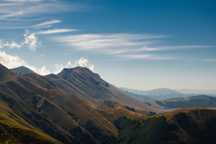 Scenic view of mountains against sky in frontignano, marche, italy