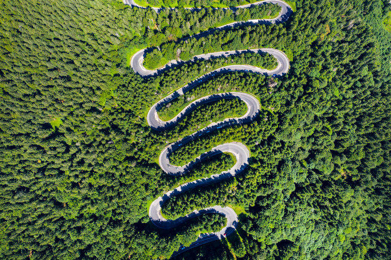 Aerial view of winding road during sunny day