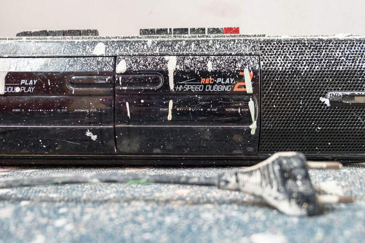 Retro radio and tape player 80s, covered with splashes of white paint. Cassette player. Worker Ancient Antenna Antique Audio Background Band Black Button Cassette Cassettes Classic Closeup Covered Dirty Electronics  Entertainment Equipment Listening Music Object Old Paint Painter Painting Player Plug Radio Recorder Retro Revival Rock Roll Sound Speaker Spray Station Stereo Style Tape Technology Tune Vintage White Work