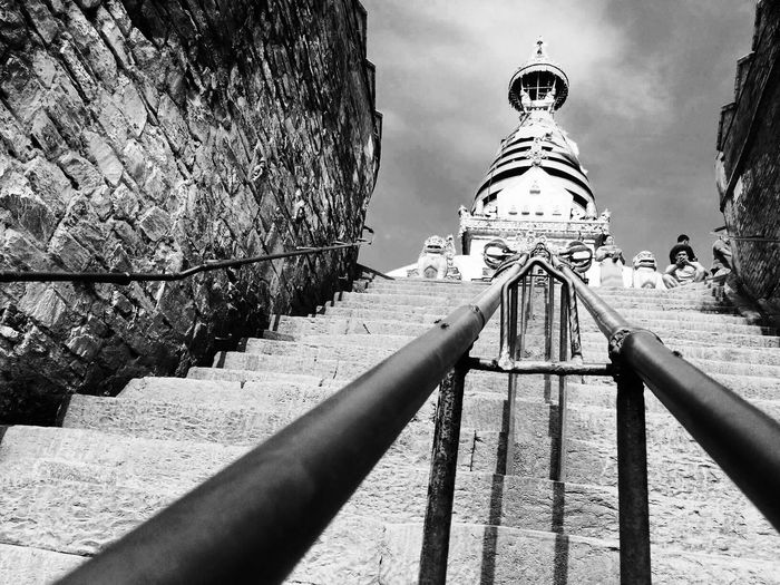 Monochrome Photography the way is tough ahead ! We Must Not Head Back this is life . Swoyambhu Monk Temple Nepal Stupa Ladders Wall Way In Nepal