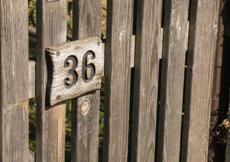Wood Wooden Fence Close-up Communication Day Fence House Number No People Number Outdoors Street Number Text Wood - Material