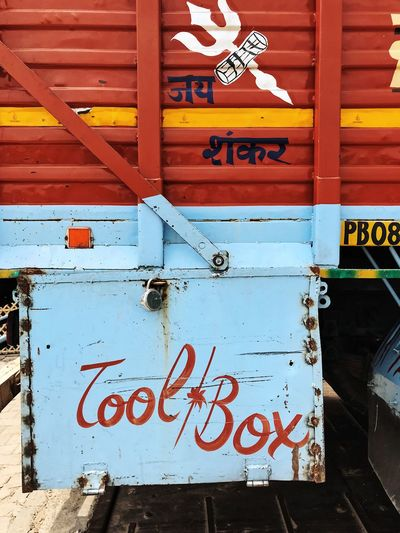 Blue Color Indian Indian Culture  Paint Painted Yellow Line Communication Day Graphic Design Guidance Handmade Handwriting  Information Information Sign No People Non-western Script Outdoors Red Script Sign Text Toolbox Truck Western Script