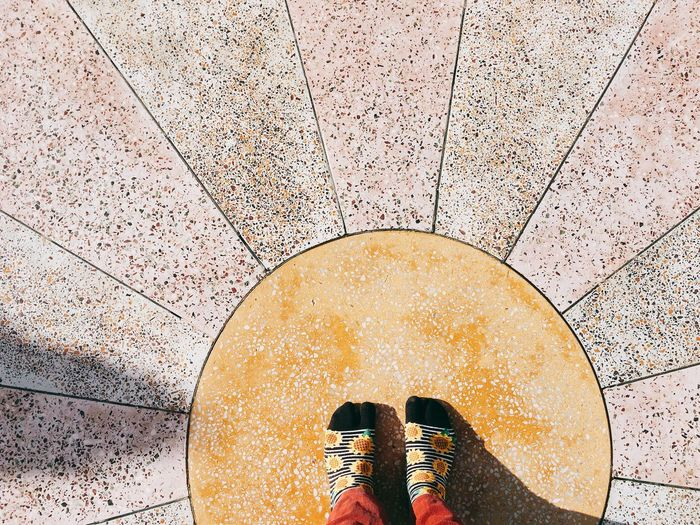 High Angle View Of Person Standing On Tiled Floor