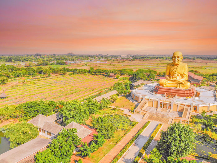 Panoramic view of temple against sky at sunset