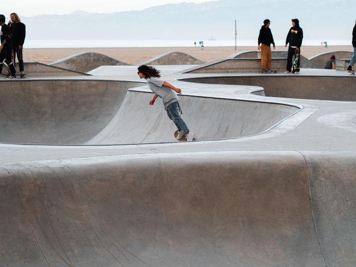 Rear view of man skateboarding