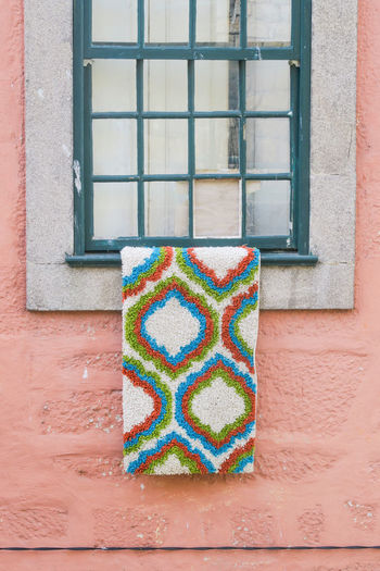 Colourful carpet hanging out of a window, porto, portugal Coulo Colorful Colourful Carpet Window Drying Hanging Multi Colored Window The Art Of Street Photography