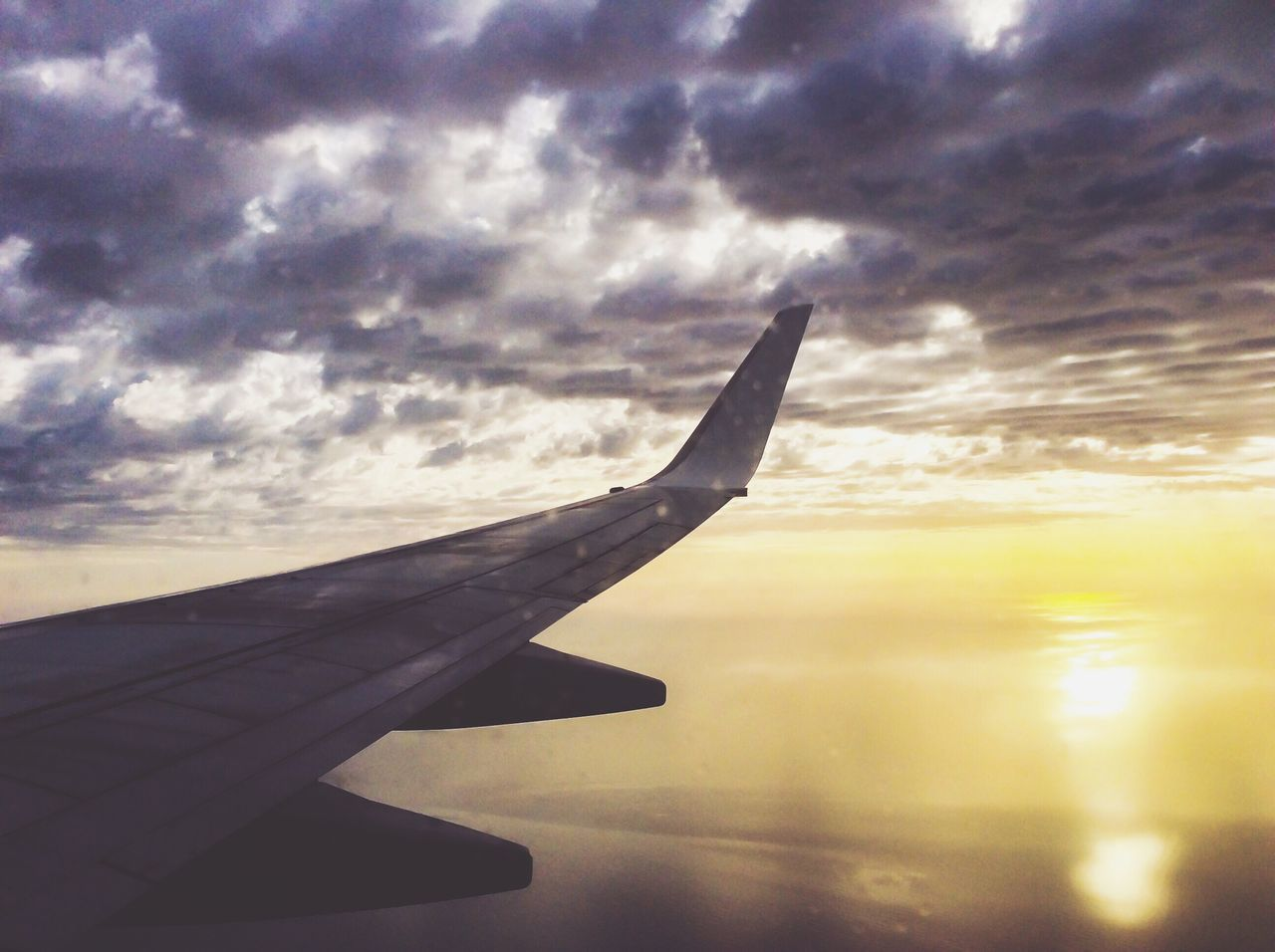 airplane, journey, sky, cloud - sky, travel, transportation, sunset, cloudscape, airplane wing, nature, flying, aircraft wing, beauty in nature, no people, mode of transport, scenics, aerial view, outdoors, air vehicle, mid-air, tranquility, close-up, day