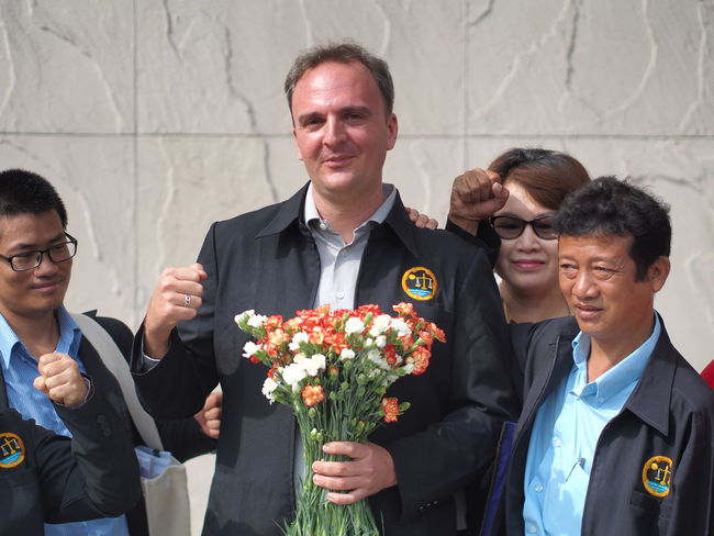 Andy Hall. English man. Human Right Defender in Thailand. Activist  Human Rights NGO Adult Bouquet Cheerful Day Flower Fragility Freshness Front View Happiness Indoors  Mature Adult Mature Men Men People Real People Senior Adult Smiling Standing Togetherness Women Young Adult