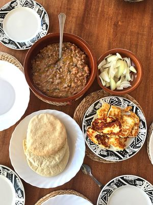 Morning breakfast making medames beans with garlic, tahini, lemon and corriander, served up with some fried halloumi and pitta bread. Family tradition for over 27 years Food And Drink Table Food Plate Indoors  Variation Bowl No People Ready-to-eat Dumpling  Day Freshness Dim Sum Palestinian Palestine Cyprus Fool