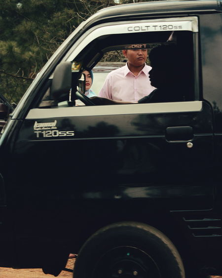 Portrait of a man in car