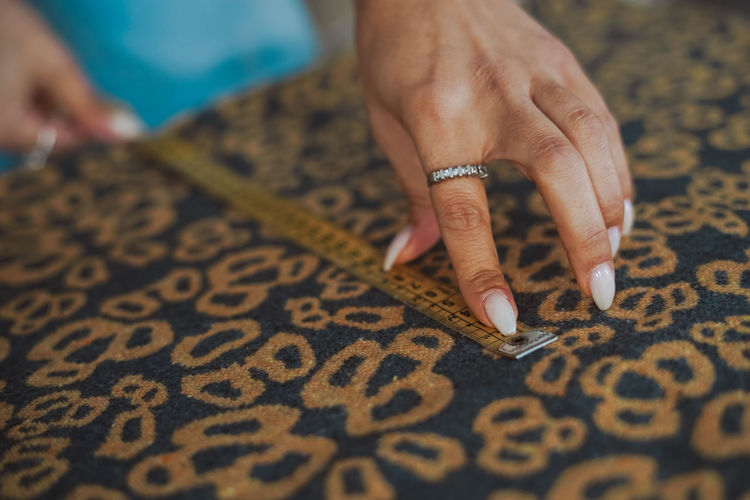 Close-up of woman hand on carpet