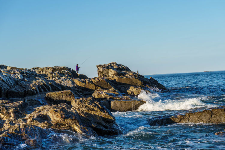 Maine Beauty In Nature Blue Clear Sky Day Fisherman Fishing Horizon Over Water Leisure Activity Lifestyles Men Motion Nature Outdoors Portland Oregon Real People Rock Rock - Object Rock Formation Scenics - Nature Sea Sky Solid Water