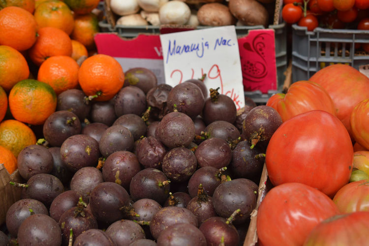 Passion-fruit, tomato, orange and other vegetables Food Freshness Healthy Eating Large Group Of Objects Market Market Stall Passion Fruit Price Tag Tomato Vegetable