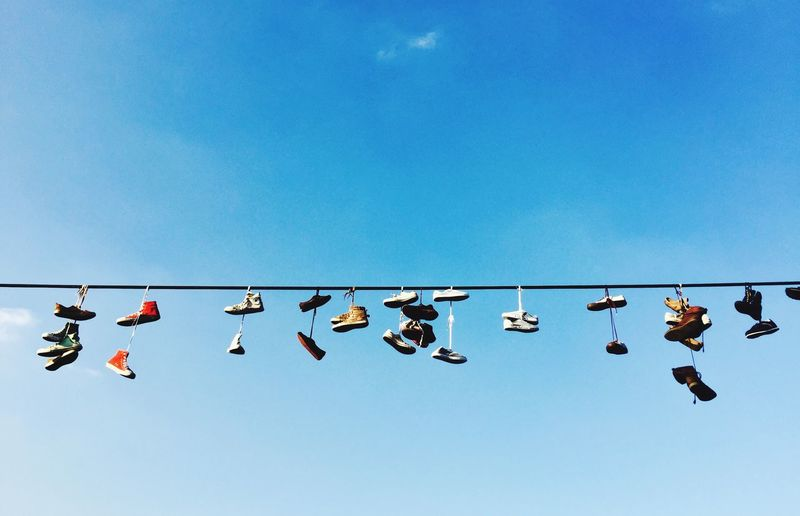 Low Angle View Hanging Copy Space In A Row Blue Day Outdoors Clear Sky No People Sky Shoes Prague