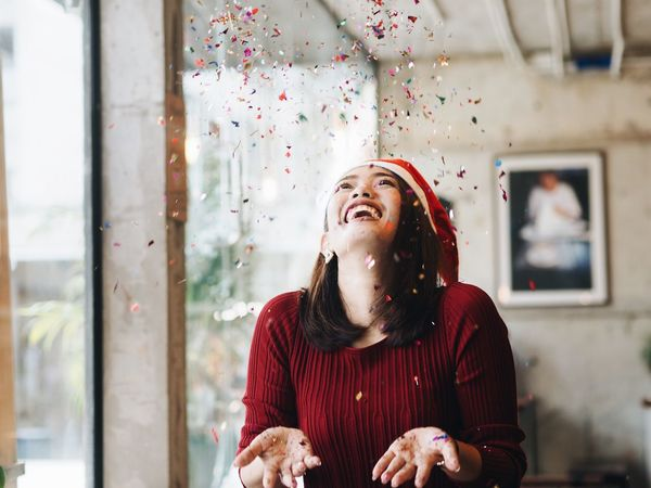 Portrait Beautiful Asian woman joyful in Christmas time. Celebration Christmas Glitter Joyful New Year Cheerful Close-up Day Focus On Foreground Front View Happiness Indoors  Joyful Moments Leisure Activity Lifestyles One Person Real People Smiling Woman Portrait Young Adult Young Women