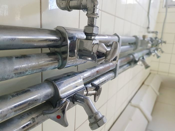 Close-up of pipes in bathroom