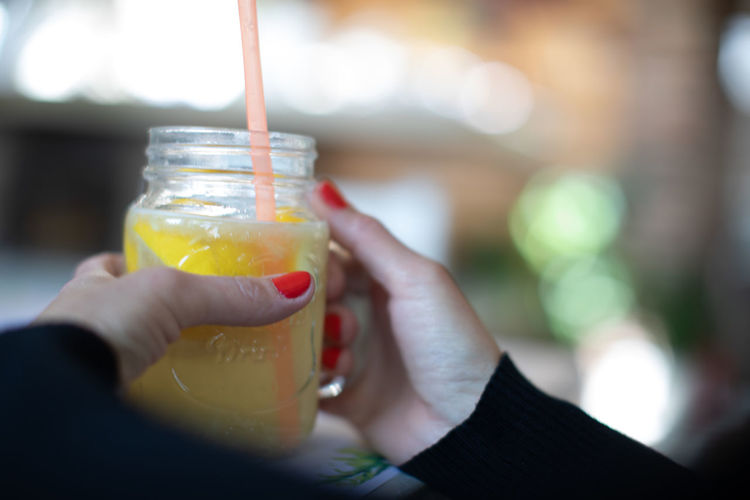 Close-up of woman hand holding drink