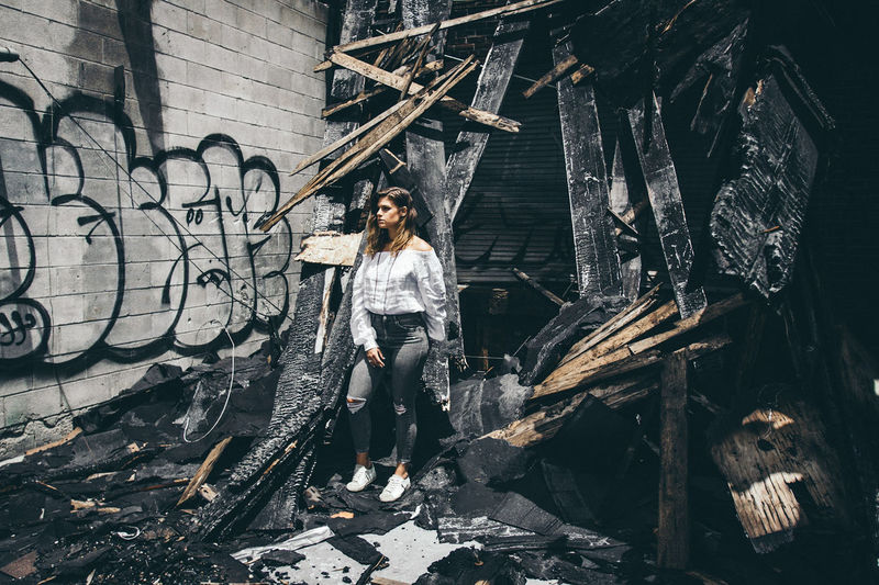 Live For The Story The Portraitist - 2017 EyeEm Awards Graffiti Front View Adult Fashion Full Length One Person Only Women Portrait Standing Adults Only One Woman Only Black Color Young Adult People Fashion Model Looking At Camera Women Real People Outdoors Young Women Beautiful Woman Lifestyles Standing