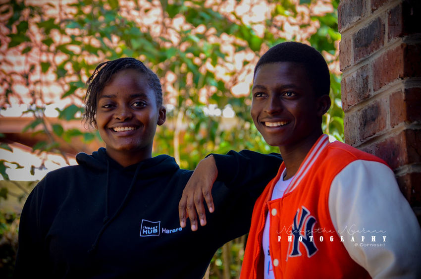 Two People Portrait Looking At Camera Smiling Real People Togetherness Lifestyles Happiness Leisure Activity People Standing Young Adult Emotion Casual Clothing Bonding