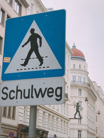 Human Representation Communication Architecture Male Likeness Guidance Road Sign Built Structure Day Building Exterior Text Outdoors Low Angle View No People City Close-up Sky Cityscape Shotoniphone7 Austria Vienna Architecture Streetphotography Schulweg Road Signal Crossing Sign