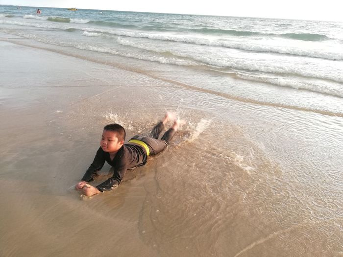 Children enjoy on summer trip 2019,หาดเจ้าหลาว Achi2019 Water Sea Land One Person Leisure Activity Beach Real People Lifestyles Motion Men Wave High Angle View Males  Holiday Nature Boys Trip Child Horizon Over Water Outdoors Boy