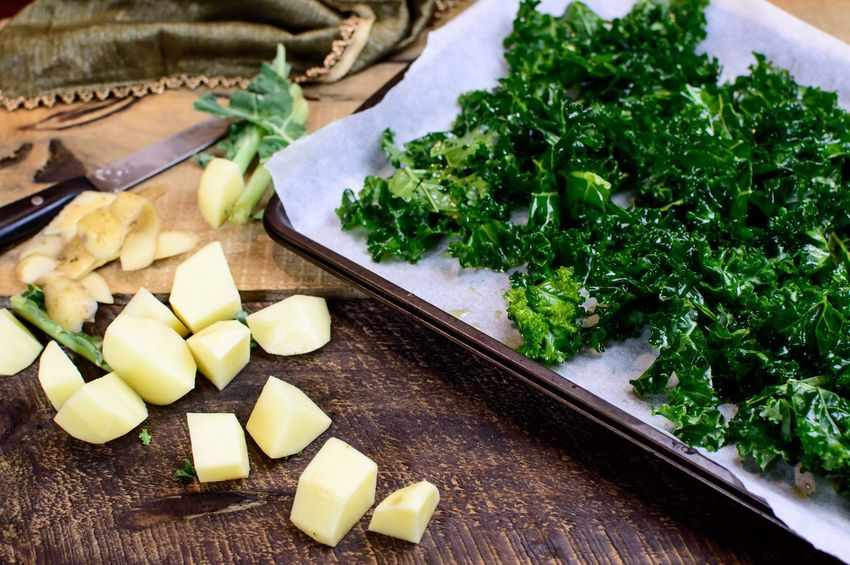 Chopped kale and potatoes on wood table Healthy Eating Wood - Material Superfoods Vegetarian Food Kale Potatoes Vegetable Cutting Board Food And Drink Kitchen Knife Freshness Indoors  Healthy Eating Food Preparation  No People SLICE Green Color Studio Shot Chopped Close-up Day Ready-to-eat Food Stories