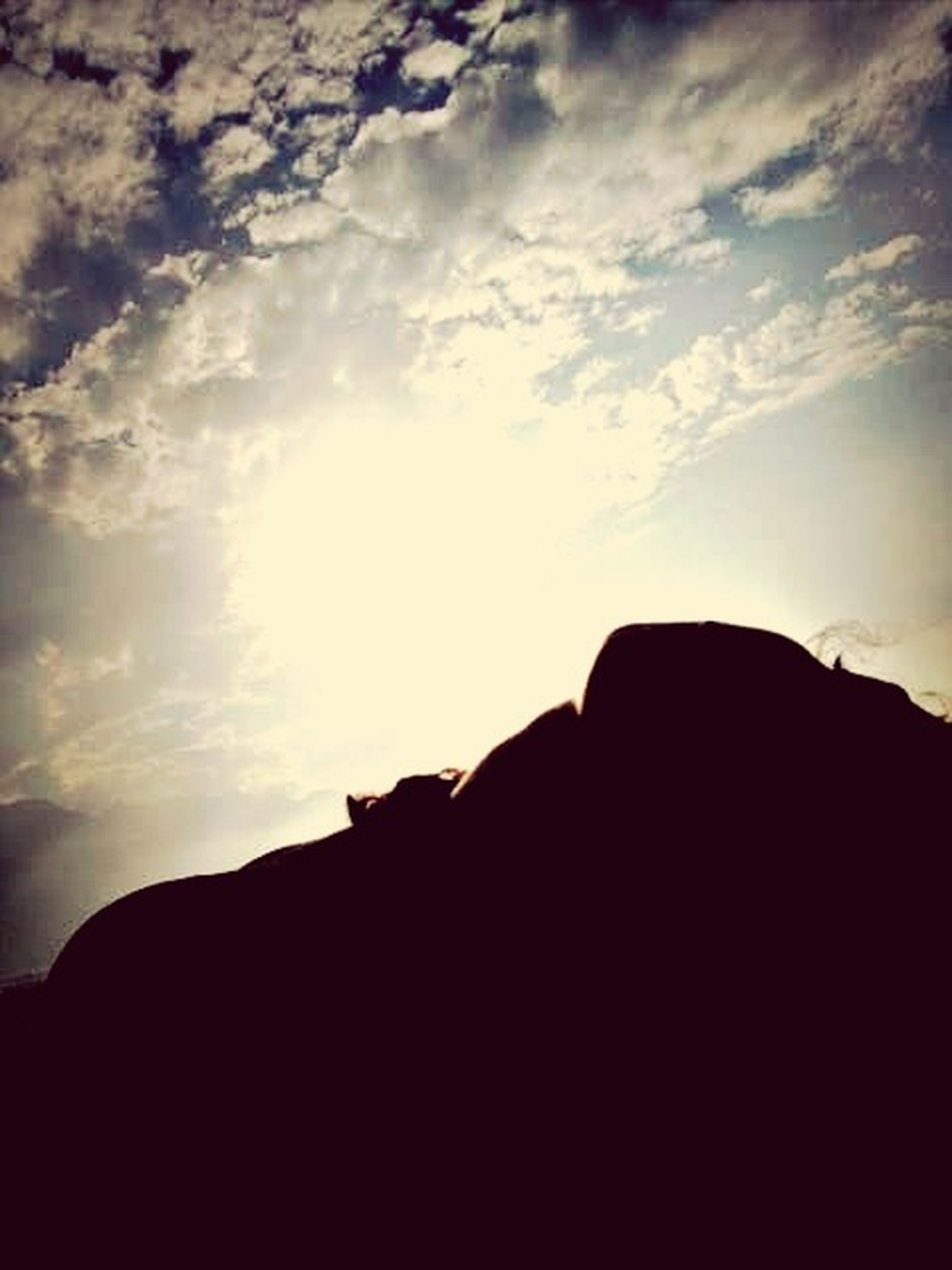 silhouette, sky, mountain, sunset, low angle view, cloud - sky, tranquility, scenics, tranquil scene, outline, beauty in nature, cloud, nature, dark, dusk, built structure, mountain range, outdoors, sunlight, idyllic