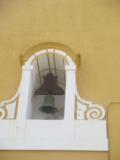 Arch Architecture Building Exterior Built Structure Chapel Church Bell Day Decoration Detail On The Wall Fortress Fortress Wall History Low Angle View Monument No People Old Fortress Ornament Outdoors Peniche Portugal Religion Religious Architecture Resisting The Time Yellow Yellow Wall Zellow Color