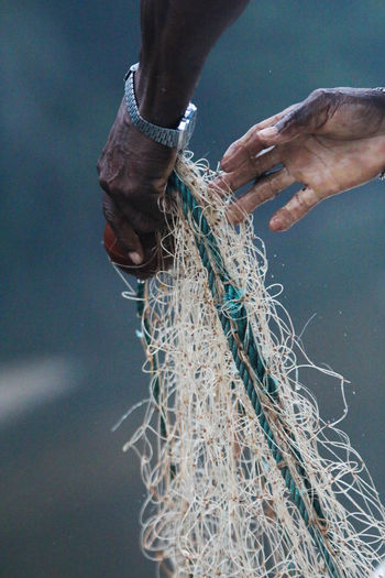 Close-Up Of Hands Holding Fishing Net