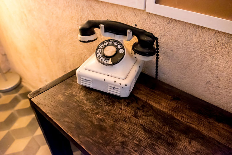 High Angle View Of Telephone On Table At Home