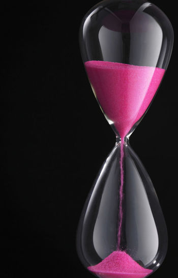Hourglass on dark background Antique Countdown Deadline Flowing Isolated Past Retro Running Black Background Clock Close-up Glass Hour Glass Hourglass Indoors  Instrument Measurement No People Old Passing Sand Single Object Still Life Time Timer