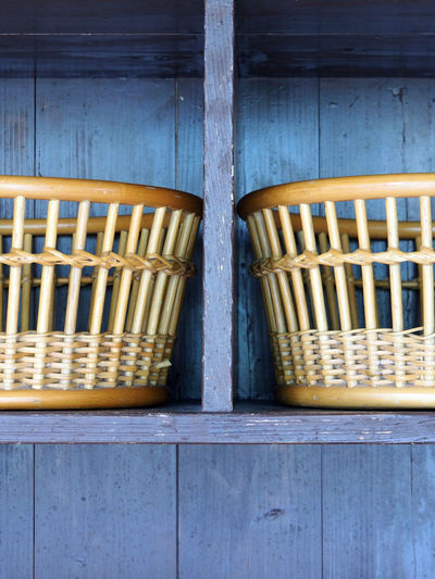 Wicker baskets on wooden shelf