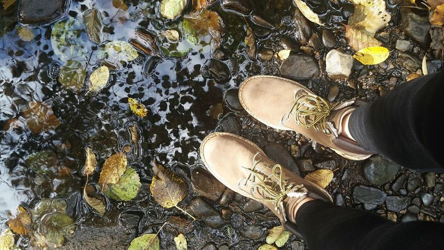 Human Body Part Real People Lifestyles High Angle View One Person Close-up Leisure Activity Low Section Outdoors Day Wintershoes Human Leg Sky Colorful Contrast Autumn Leaves Tranquility Beauty In Nature Reflections Water Leaves Autumn Schoes People Adult