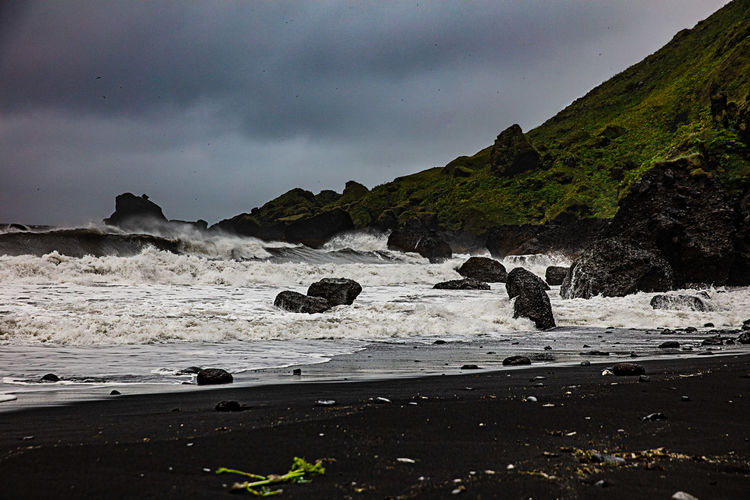 Sky Water Beauty In Nature Sea Cloud - Sky Beach Scenics - Nature Rock Land Mountain Nature Motion Wave No People Outdoors Flowing Water Power In Nature Blackbeach Vik Vik Iceland Stormy Weather Storm,