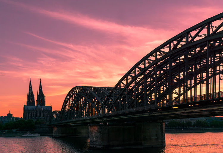 View on the Cologne Cathedral and the Hohenzollern Bridge in the Evening Light. Architecture Bridge City Cologne Cologne Cathedral Evening Germany Light Rhine Romantic Silhouettes Skies Sky Travel Destinations Twilight Warm Water Tourist Attraction  Hohenzollernbridge