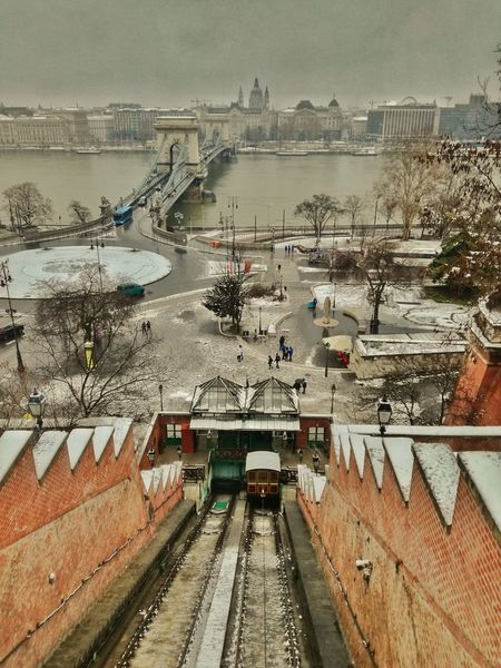 budapest, salita al castello reale Esteuropa Viaggiavventura Budapest Budapesthungary Canon1300d📷 Instatravel Budapesthungeryblog Beautifuldestination Viaggia Lifeofexploring Travelingram Passionpassport Lifeintravel Ungheria Travelstyle Travelpics Travelinspired Igtravel #landscape #nature #photography Shades Of Winter Transportation High Angle View Railroad Track Outdoors Day Water No People