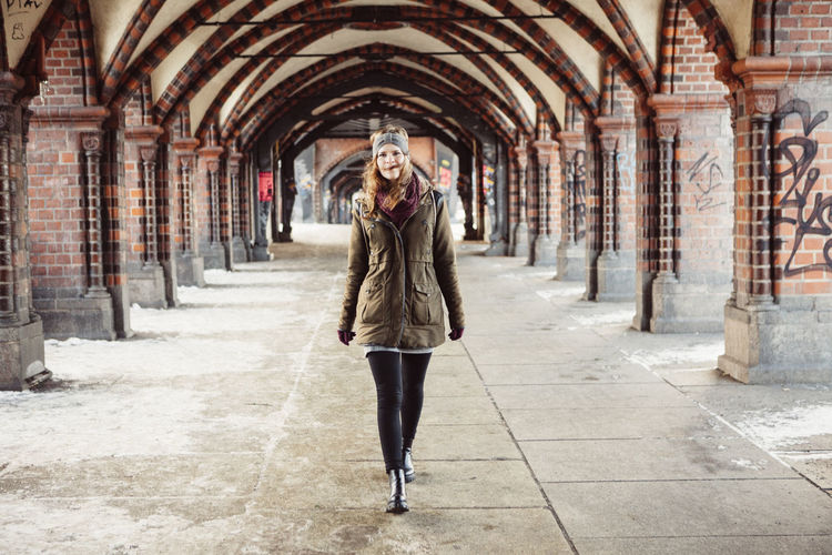 Portrait Of Beautiful Young Woman Walking At Railroad Station Platform