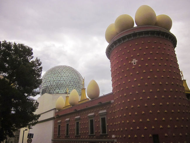 Salvador Dalí Theatre and Museum. The museum of the artist Salvador Dalí in his home town of Figueres, in Catalonia, Spain. Dali is buried there in a crypt below the stage. Architecture Art Artist Artistic Building Exterior Built Structure Cloud - Sky Crypt Cultures Dome Façade Famous Place Figueres Figueres, Spain High Section Low Angle View Museum Of Modern Art No People Outdoors Salvador Dali Sky Spire  Tourism Tower Travel Destinations