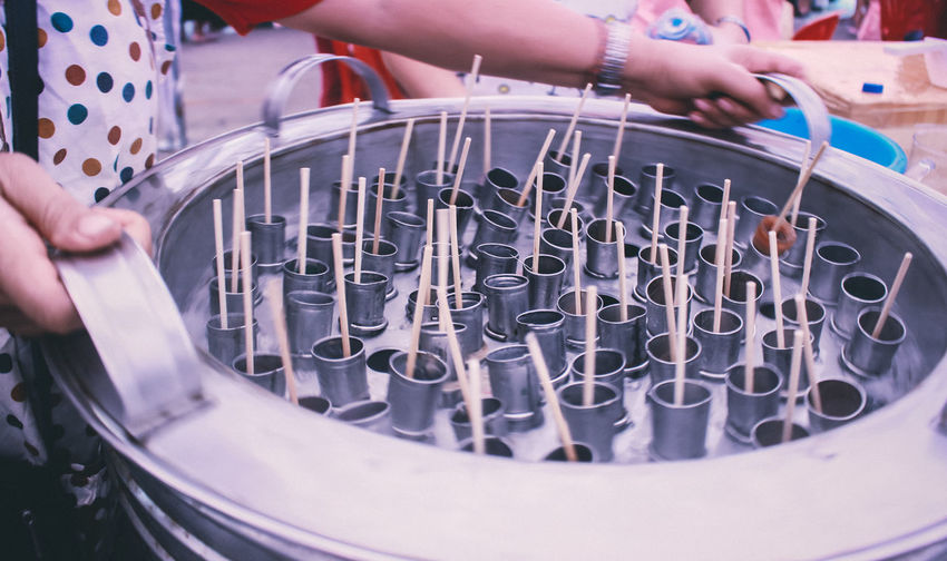 Cropped Image Of Holding Ice Lollies Molds