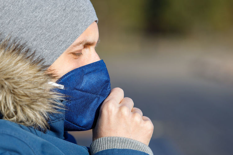 Close-up of man wearing mask outdoors