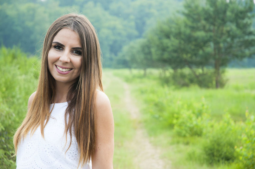 Nature Beautiful Woman Beauty Brown Hair Emotion Focus On Foreground Front View Hair Hairstyle Happiness Happyness Headshot Long Hair Looking At Camera One Person Outdoors Plant Portrait Smile Smiling Space For Text Standing Wahnerheide Young Adult Young Women