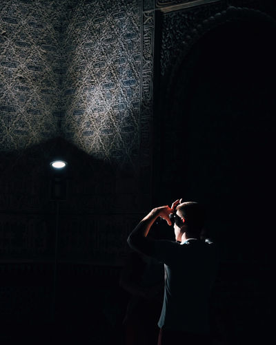 Roadtrip around Andalsuia. 2nd stop: Granada One Person Lifestyles Indoors  Illuminated Dark Leisure Activity Activity Casual Clothing Rear View Lighting Equipment Pattern Streetphotography Light And Shadow Shadow Capture Tomorrow Silhouette Silhouette_collection 17.62°