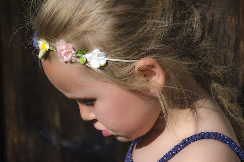 Close-up portrait of a girl with pink flower