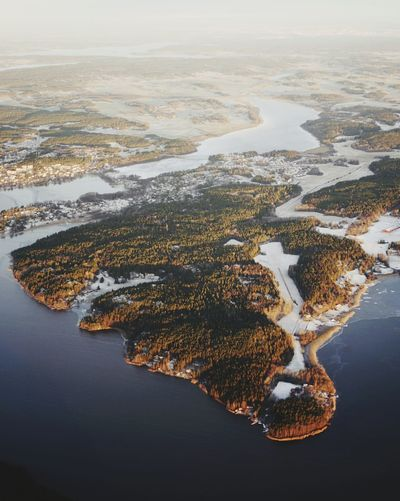 Aerial view of lake against sky during winter