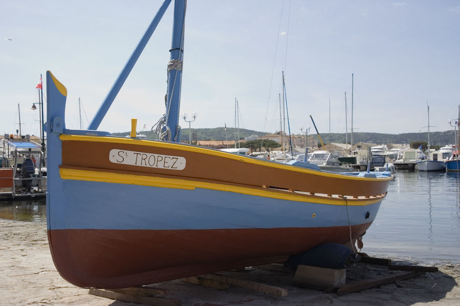 vintage boat in saint-tropez - french riviera, mediterranean sea Boat Côte D'Azur Drydock France Harbor Jolly Jollyboat Mediterranean Sea Nautical Vessel No People Old Port Provence Sailboat Saint Tropez Saint-Tropez Sea Stranded Text Transportation Vintage Water Wharf Wood - Material Wooden