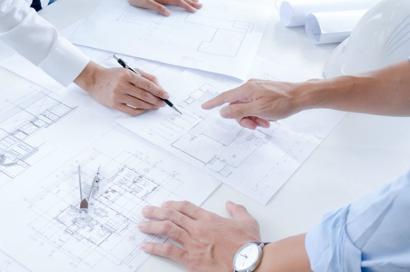 ARCHITECT Architectural Architecture Background Blueprint Building Business Busy Caucasian Communication Computer Concept Construction Creativity Design Designer  Designing Desk Drawing Engineer Engineering Equipment Group Hand Home House Industrial Industry Job Making Man Meeting Model Modern Office Paper People Plan Planning Professional Project Real Sketch Table Team Technology Work Worker Working Workplace Adult Indoors  Construction Industry Men Human Hand Women Cooperation High Angle View Occupation Document Real People Teamwork Design Professional Coworker Paperwork