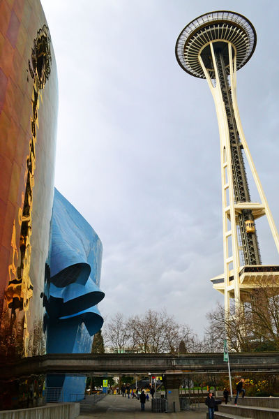Detail of the EMP museum structure in Seattle with the space needle in the background Architecture Entrance EyeEmNewHere Frank Gehry Modern Reflection Seattle Space Needle Transportation Architecture Contemporary Day Details Emp Enjoying Life Facade Building Futuristic Architecture Metal Organic Organic Shapes Outdoors Rail Way Shapes And Forms Steel Structure